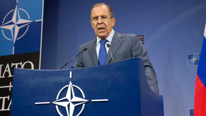Russian Foreign Minister Sergei Lavrov gives a press conference following a meeting of Nato's Foreign Affairs minister at the organisation's headquarters in Brussels on December 4, 2013.(AFP Photo / Virginia Mayo)