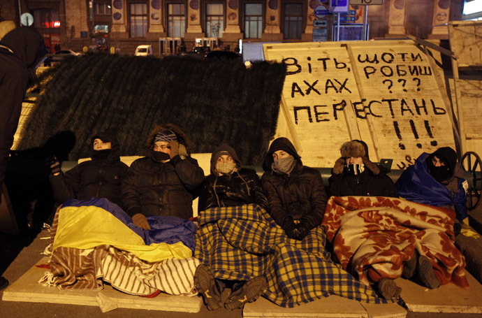 Protesters rest at a barricade at Independence Square in Kiev December 3, 2013. (Reuters//Vasily Fedosenko)