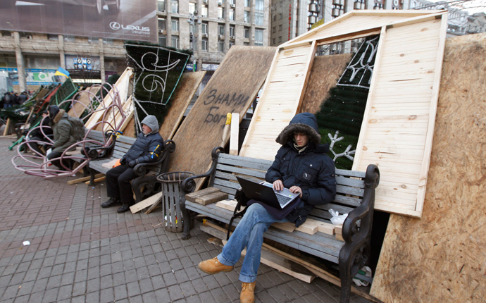 Protesters sit on barricades which blocked the main avenue in Kiev December 2, 2013. (Reuters / Vasily Fedosenko)