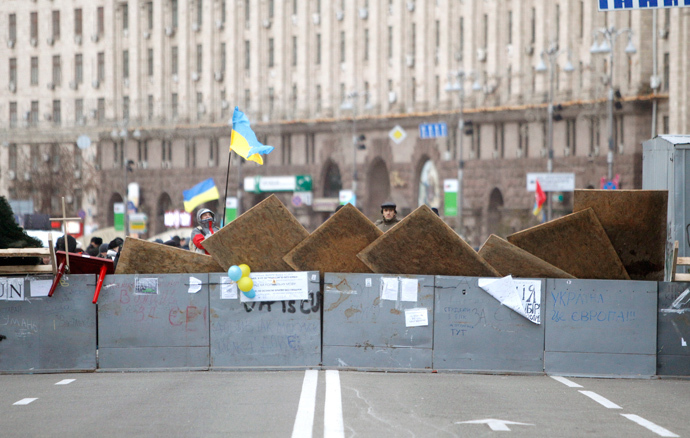 Protesters are seen near barricades which blocked the main avenue in Kiev December 2, 2013. (Reuters / Vasily Fedosenko)