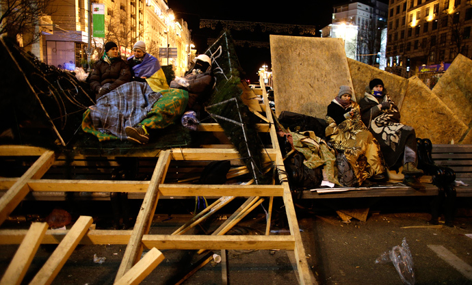 Protesters supporting EU integration rest on a barricade at Independence Square in Kiev December 2, 2013. (Reuters / Stoyan Nenov)