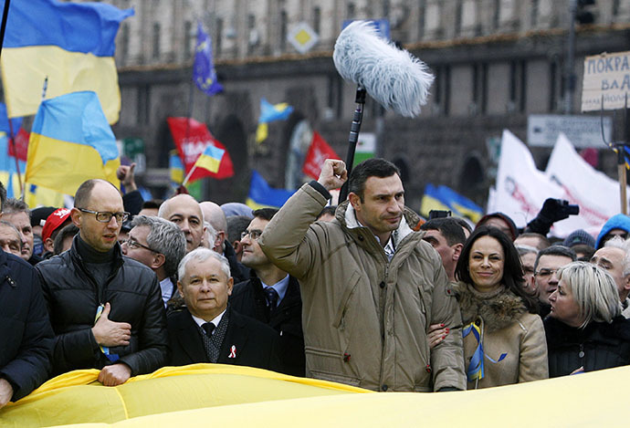 Vitaly Klitschko (3rd R, first row), heavyweight boxing champion and UDAR (Punch) party leader, Arseny Yatsenyuk (L, first row), a Ukrainian opposition leader, and Jaroslaw Kaczynski (2nd L, first row), leader of Poland's main opposition Law and Justice Party (PiS), attend a rally held by supporters of EU integration in Kiev, December 1, 2013. (Reuters / Vasily Fedosenko)