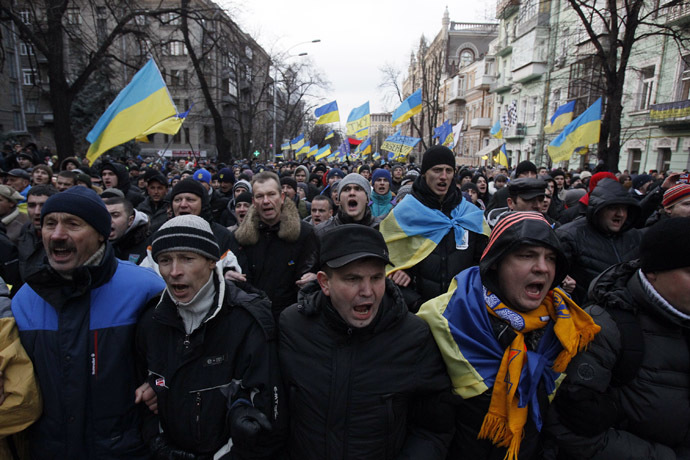 Protestors wave flags and shout slogans during a demonstration in support of EU integration in Kiev December 3, 2013. (Reuters/Gleb Garanich)