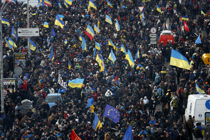Protesters wave flags as they make their way to Independence Square in Kiev December 3, 2013. (Reuters/Stoyan Nenov)