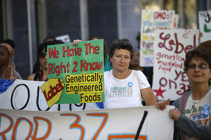 A demonstrator holds a sign during a rally in support of the state's upcoming Proposition 37 ballot measure in San Francisco (Reuters / Stephen Lam)