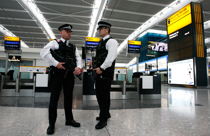 Police officers patrol the check-in hall in the new Terminal 5 building at London's Heathrow Airport (Reuters / Alessia Pierdomenico)
