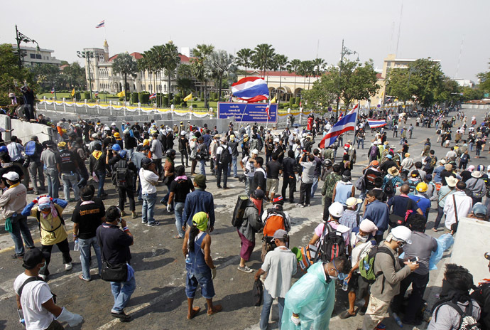Anti-government protesters gather around the Government House during a rally in Bangkok December 3, 2013. (Reuters/Chaiwat Subprasom)