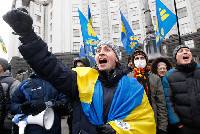 People shout slogans in front of the Ukrainian cabinet of ministers building during a rally to support EU integration in Kiev December 4, 2013.(Reuters / Vasily Fedosenko)