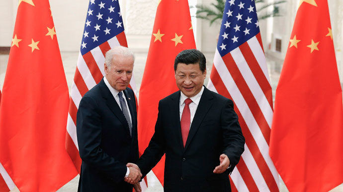 Chinese President Xi Jinping (R) shakes hands with U.S. Vice President Joe Biden (L) inside the Great Hall of the People in Beijing December 4, 2013.(Reuters / Lintao Zhang)