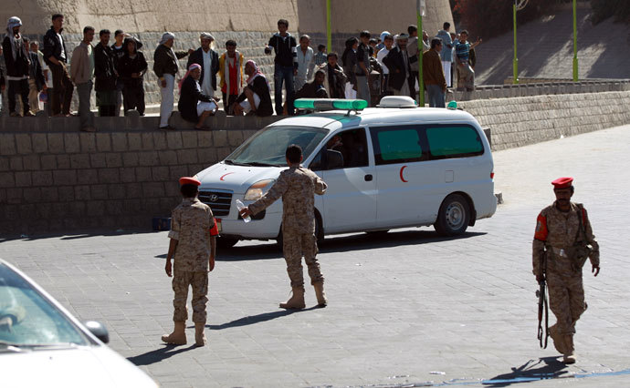 Emergency personnel arrive at the site of a suicide car bombing at the defence ministry in the Yemeni capital Sanaa on December 5, 2013.(AFP Photo / Mohammed Huwais)