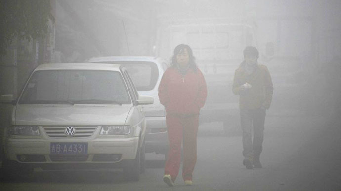 Beijing raises pollution alert to orange for first time as heavy smog blankets capital