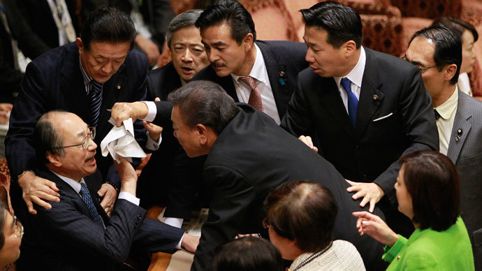 Japan parliament panel overrules protest to pass divisive state secrets bill
