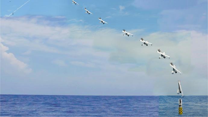 Time-lapse φωτογραφία δείχνει την έναρξη ενός μη επανδρωμένου αεροσκάφους από το βυθισμένο υποβρύχιο USS Providence.  (Φωτογραφία: NAVSEA-AUTEC)