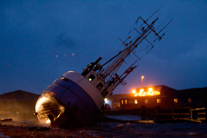 A boat lying on the side, on December 6, 2013 in Thorsminde Harbour, on the west coast iin Jutland as storm Haver hits Denmark. (AFP Photo / Scanpix Denmark / Keld Navntoft / Denmark out)