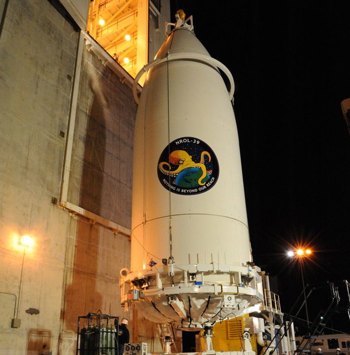 In preparation for launch, the NROL-39 payload, encapsulated within a 5-meter diameter payload faring, is transported and mated to its United Launch Alliance (ULA) Atlas V booster at Vandenberg's Space Launch Complex-3. (Photo from www.ulalaunch.com)