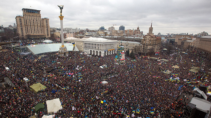 "A view of protesters gathered for a mass rally called ""The March of a Million"" in Kiev's Independence Square on December 8, 2013. (AFP Photo / Inna Sokolovskaya)"