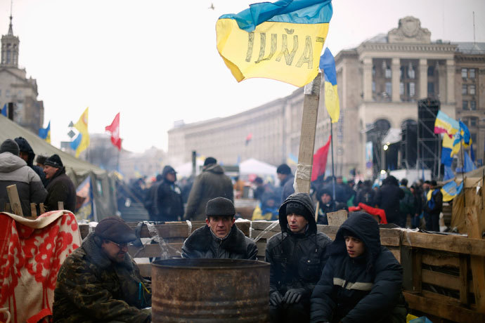 Protesters warm up near a barricade at Independence Square in Kiev December 7, 2013. (Reuters / Stoyan Nenov)