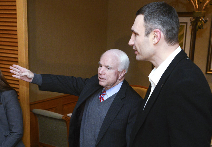 US Senator John McCain (L) gestures as he speaks to Head of UDAR (Punch) party Vitali Klitschko during a meeting with leaders of Ukrainian opposition in Kiev on December 14, 2013. McCain arrived to Ukraine over the weekend, a trip that will make him the highest-ranking US official to visit the former Soviet republic since protests erupted there last month over Kiev's move to tighten ties with Moscow. (AFP Photo / Batkivshchyna Party Press-Service Pool / Andrew Kravchenko)