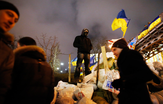 A pro-European integration protester stands on a barricade during a rally at Independence Square in Kiev December 17, 2013 (Reuters / Marko Djurica)