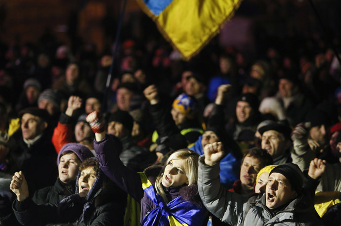 Demonstrators shout slogans during a rally held by Pro-European integration protestors in the early morning hours in central Kiev, December 17, 2013. (Reuters)