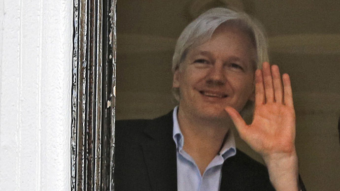 WikiLeaks founder Julian Assange waves from a window at Ecuador's embassy in central London (Reuters/Chris Helgren)