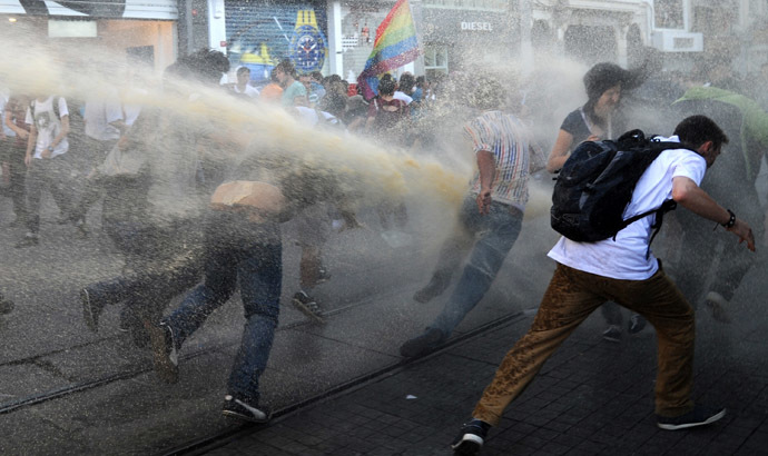Turkish police disperse anti-government protestors with water cannons during a protest at the entrance of Taksim Square on July 20, 2013, in Istanbul. (AFP Photo/Bulent Kilic)