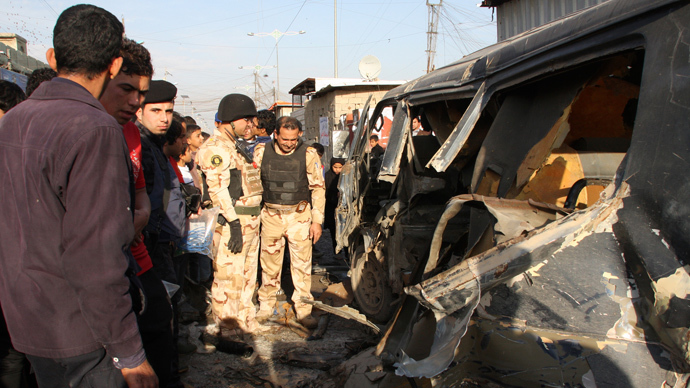 Iraqi security forces inspect the site of car bomb attack in Baghdad's Sadr city December 8, 2013. (Reuters / Wissm al-Okili)