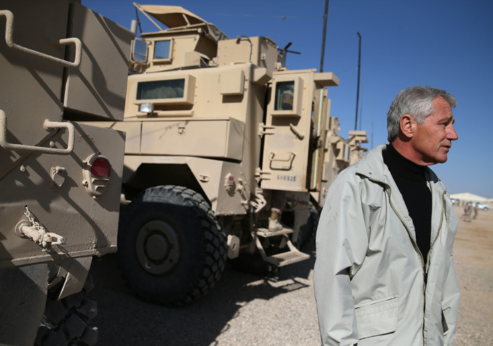 U.S. Secretary of Defense Chuck Hagel stands next to MRAP vehicles after speaking to US troops, on December 8, 2013 in Kandahar. (AFP Photo / Pool Mark Wilson)