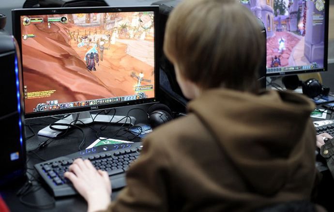 "A visitor plays the computer game ""World of Warcraft"" at the world's biggest high-tech fair, the CeBIT (AFP Photo / Nigel Treblin)"