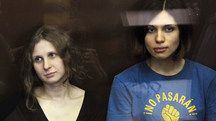The members of the Pussy Riot punk band Maria Alyokhina and Nadezhda Tolokonnikova during the announcement of the verdict on their case at Moscow's Khamovniki Court (RIA Novosti / Aleksandr Utkin)