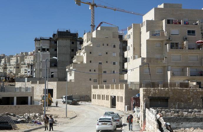 Labourers work at a housing construction site in the Israeli settlement of Har Homa in east Jerusalem (AFP Photo/Menahem Kahana)