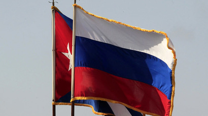 The Cuban and Russian national flags (Reuters/Enrique De La Osa)