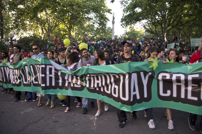 People march for the legalization of marijuana towards the Legislative Palace in Montevideo, on December 10, 2013, as the Senate discuss a law on the legalization of marijuana's cultivation and consumption. (AFP Photo/Pablo Porciuncula)