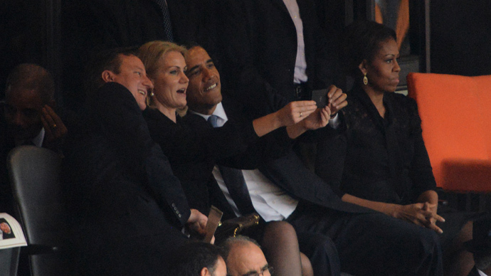 Obama poses for selfie with Cameron, Danish PM at Mandela memorial service