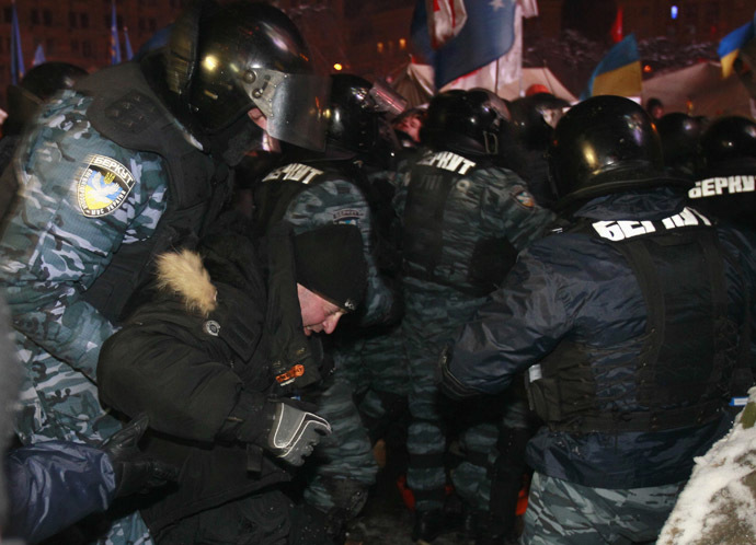 Riot police officers detain a protester in Kiev December 11, 2013. (Reuters/Gleb Garanich)