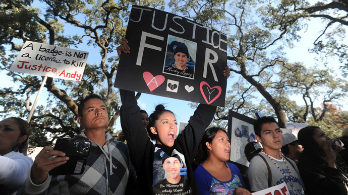 Vigil for teen found shot in police car ends with tear gas, arrests