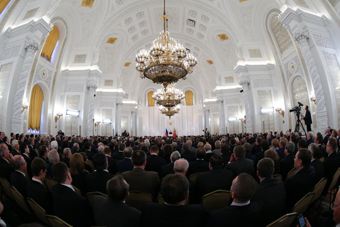 The audience listen to Russia's President Vladimir Putin as he gives his annual state of the nation address at the Kremlin in Moscow, December 12, 2013. (Reuters / Sergei Karpukhin)