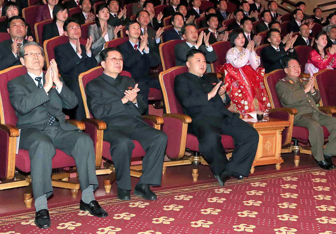 North Korean laeder Kim Jong-Un (C-front) and his uncle, Jang Song-Thaek (front 2nd L).(AFP Photo / KCNA)