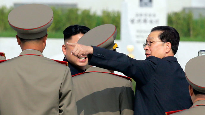 North Korean politician Jang Song-thaek (R) gestures next to North Korean leader Kim Jong-un (L) as they attend a commemoration event at the Cemetery of Fallen Fighters of the Korean People's Army (KPA) in Pyongyang.(Reuters / Jason Lee)