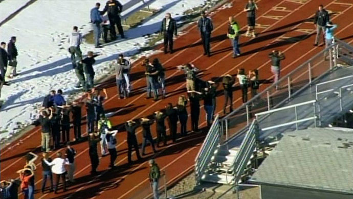 In this framegrab taken from video by KCNC television news in Denver, students of Arapahoe High School in Centennial, Colorado, line up to be checked by police at a running track on December 13, 2013 after a shooting at the school. (AFP Photo / KCNC)