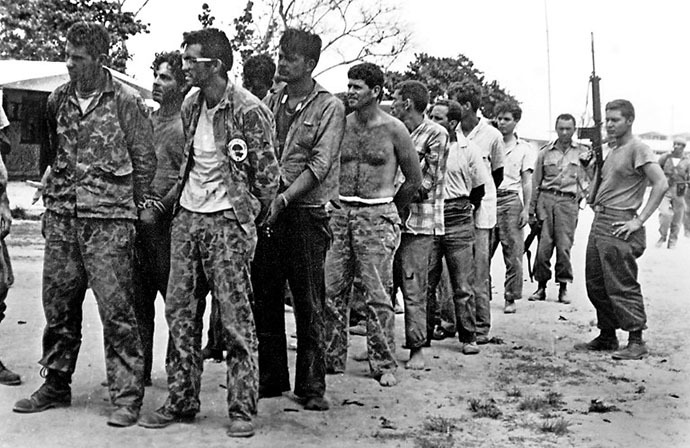 (FILES): This April 1961 file photo shows a group of Cuban counter-revolutionaries, members of Assault Brigade 2506, after their capture in the Bay of Pigs, Cuba. (AFP Photo / Miguel Vinas)