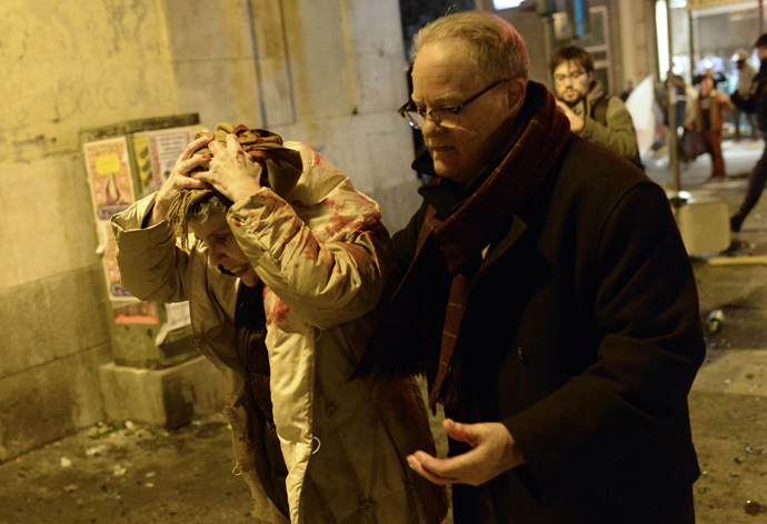 "A woman holds her bloodied head as supporters of anticapitalist social movement Rodea El Congreso demonstrate outside the congress during a protest dubbed ""Surround the congress"" in Mardrid on December 14, 2013 demanding a change towards a, ""genuine social democracy"". (AFP Photo / Dani Pozo)"
