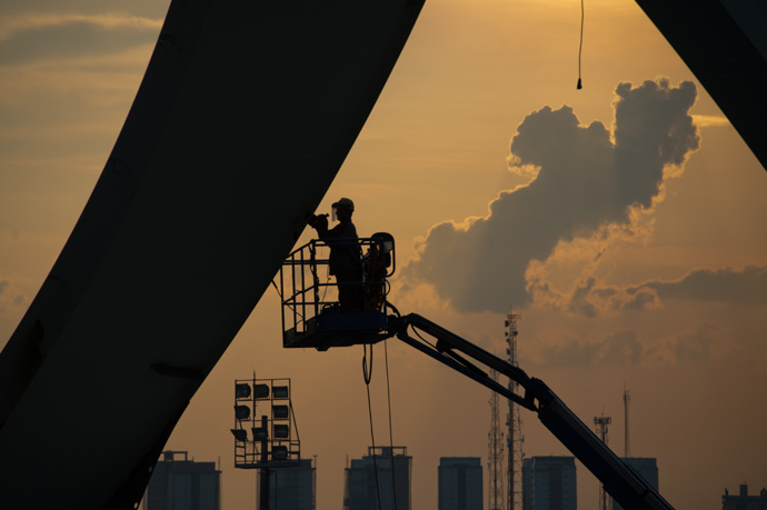 A man working at the Arena da Amazonia stadium. (AFP Photo / Christophe Simon)