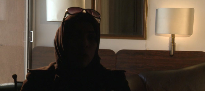 One of the witnesses of the Adra massacre, who spoke to RT on condition of anonymity. Still from RT video