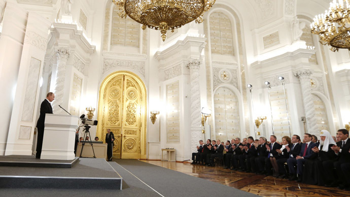 Russian President Vladimir Putin reads his annual address to the Federal Assembly in the St. George's Hall of the Kremlin. (RIA Novosti/Dmitry Astakhov)