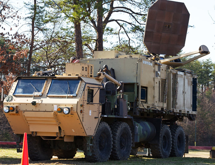 A US Marine Corps truck is seen carrying a palletized version of the Active Denial System, March 9th, 2012, at the US Marine Corps Base Quantico, Virginia. It is a US DoD non-lethal weapon that uses directed energy and projects a beam of man-sized millimeter waves up to 1000 meters that when fired at a human, delivers a heat sensation to the skin and generally makes humans stop what they are doing and run. (AFP Photo/Paul J. Richards)