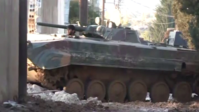 The Syrian army on a mission to force rebels out of the town of Adra. Still from RT video