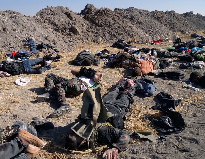 A handout picture released by the Syrian Arab News Agency (SANA) allegedly shows bodies of rebel fighters after being ambushed by government forces in the industrial city of Adra outside Damascus, on July 21, 2013 (AFP Photo / SANA)