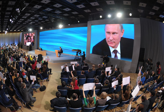 President Vladimir Putin facing reporters at the annual Q&A session in the World Trade Center, Krasnyaa Presnya, Moscow, December 19, 2013.(RIA Novosti / Aleksey Nikolskyi)