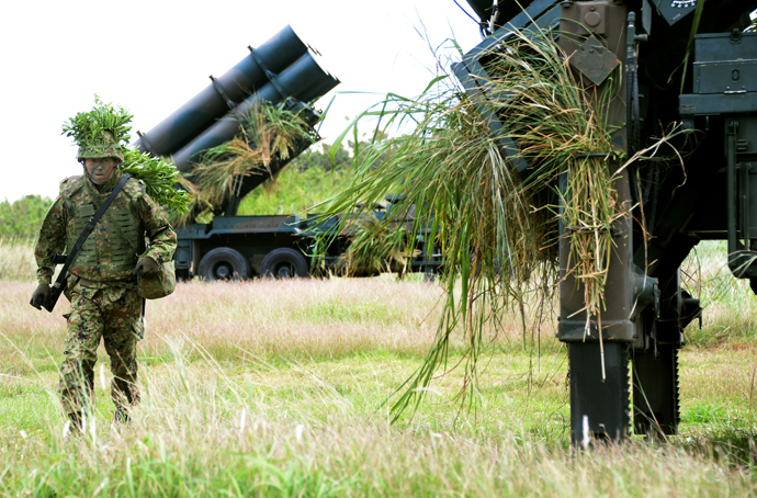 A soldier from Japan's Ground Self-Defense Force helps to prepare surface-to-ship missile launchers at Camp Naha in Naha, Okinawa Prefecture (AFP Photo / Toru Yamanaka)